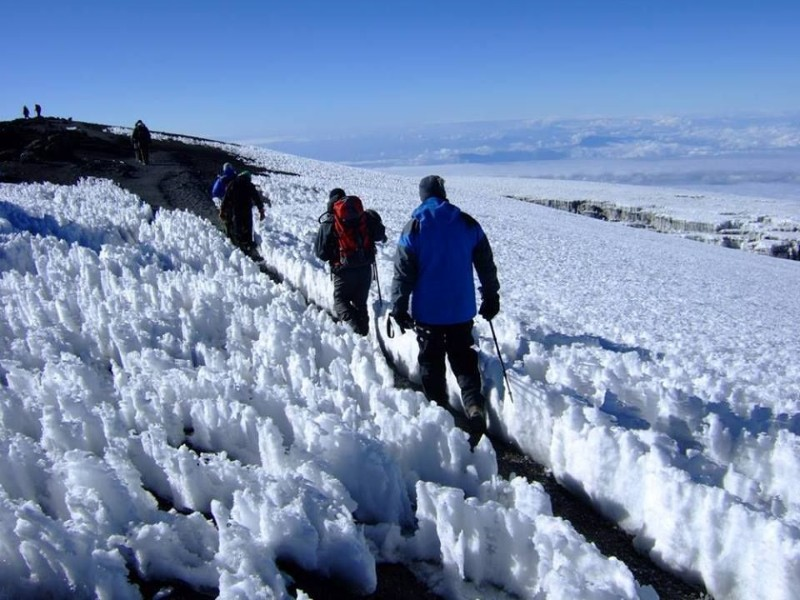 """The Machame route; well known as the """"Whiskey Route"""" begin in the south of the mountain. It is the most-travelled route on Kilimanjaro taking more than [themify_button bgcolor=""""green"""" size=""""large"""" link=""""https://trekandhideadventures.com/machame-r/"""" style=""""button""""]Read More[/themify_button]"""