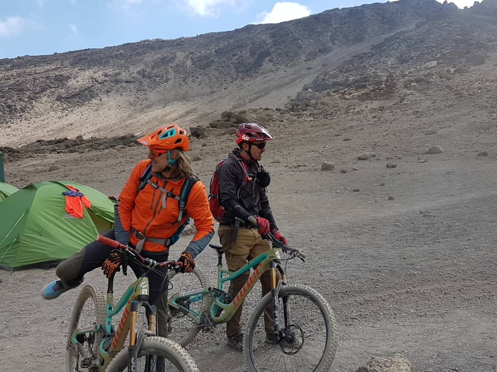 """We start cycling from our Lodge towards the Moshi - Arusha road. It is a short day but a bit tough as we go uphill around parts of north-west Kilimanjaro   [themify_button bgcolor=""""green"""" size=""""large"""" link=""""https://trekandhideadventures.com/cycle-kilimanjaro-to-lake-natron/"""" style=""""button""""]Read More[/themify_button]"""